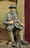 WWI British Infantryman sitting on a case